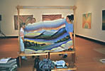 cutting the tapestry off the loom in Two Rivers Art Gallery, Prince George, BC